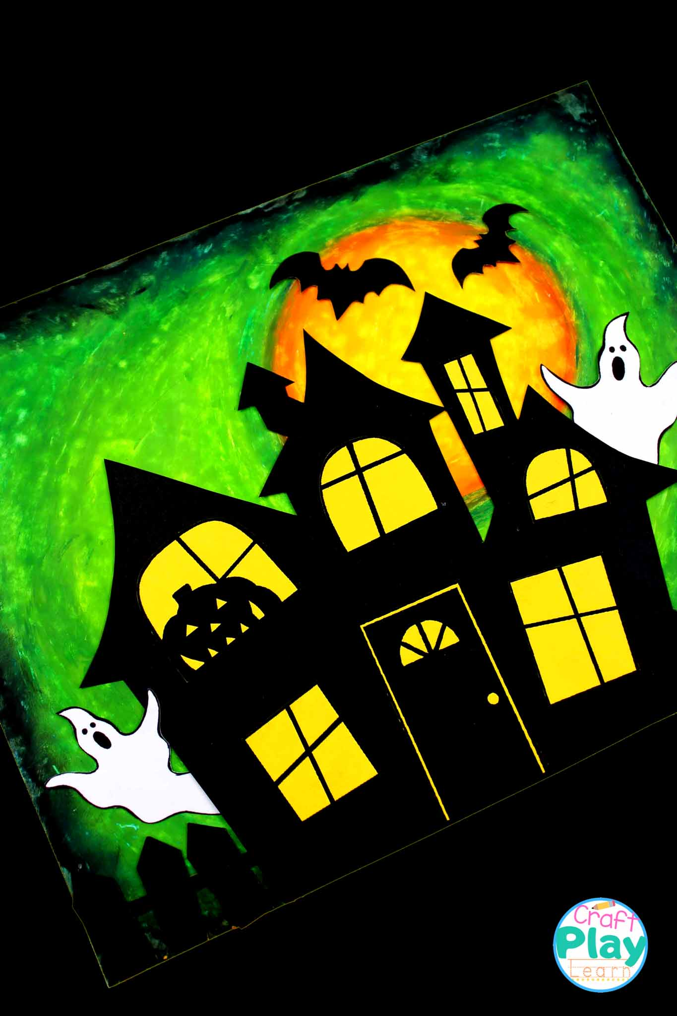 making a orange coloured haunted house with kids