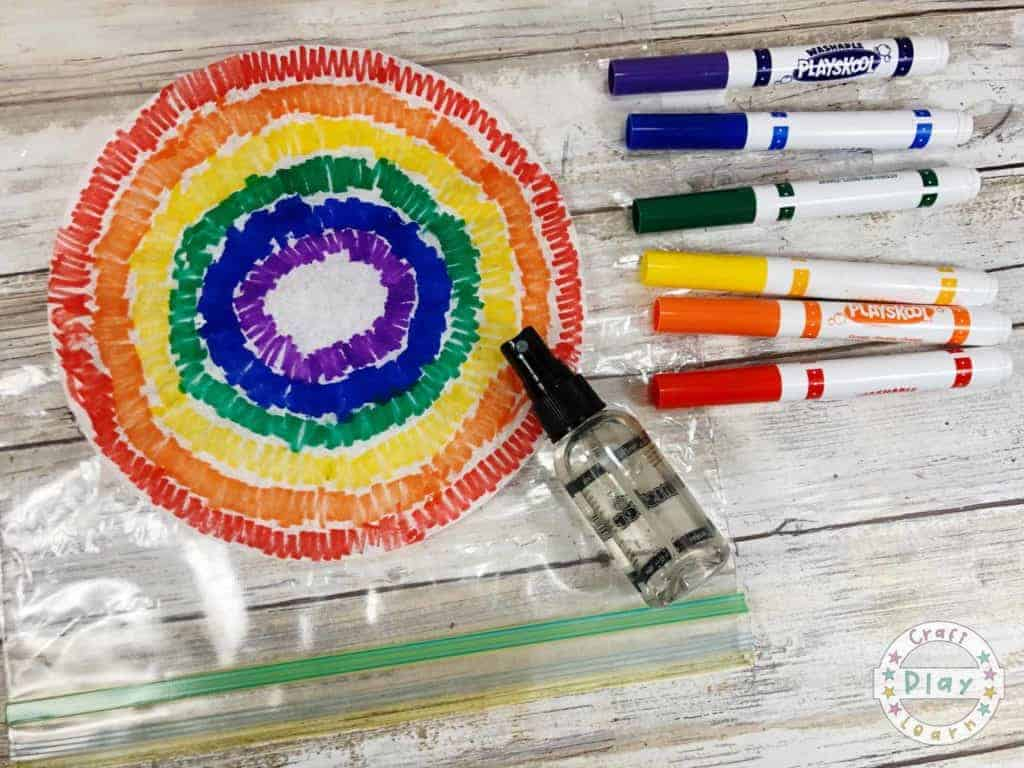 coloring the coffee filter with felt tips