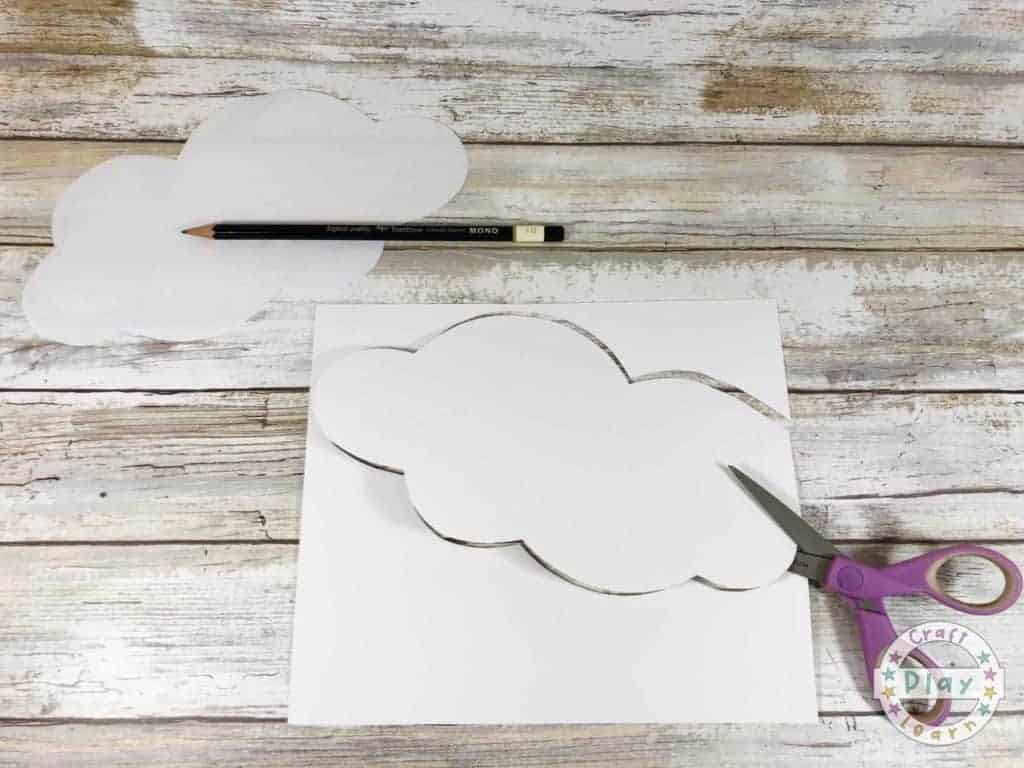 cutting out a cloud from paper